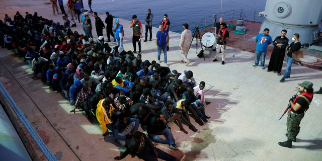 Migrants arrive at a naval base in Libya.