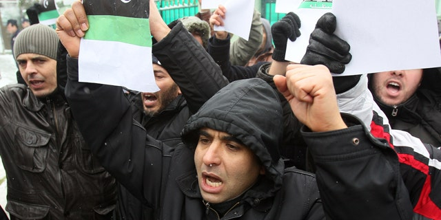 Feb. 22, 2011: A Libyan citizens in Serbia protest against Moammar Gadhafi in front of the embassy in Belgrade, Serbia.  About 30 Libyans gathered at the protest against Gadhafi's crackdown on peaceful protesters in Libya.