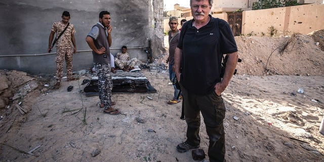 """Robert Young Pelton in the city of Sirte in May 2017 as soldiers belonging to the """"Bunyan Marsous"""" - Misrata militias who fought in Sirte to run ISIS out of its Libyan stronghold."""