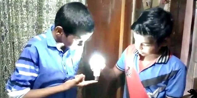Scientists in India are buzzing about an electrifying discovery - one boy's extraordinary ability to bring light where there was darkness.  See SWNS story SWBULB.  While experts say each of us has a magnetic field -  N Abu Thahir's is strong enough to illuminate a bulb by touch alone.  According to the science journals, the human body, at any given moment, produces energy equivalent to a 100 watt light bulb. But only a handful of people have been able to channel that energy to produce light.  Thahir, a Grade VII student from Alapuzzha, Kerala, is one of them. He can light a rechargeable LED bulb by pressing it to any part of his body.