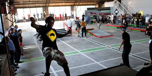 Sept. 26, 2012: Recording artist Lil Wayne skates in a new skateboard park he helped finance along with Glu Agency and Mountain Dew, in the Lower Ninth Ward of New Orleans.