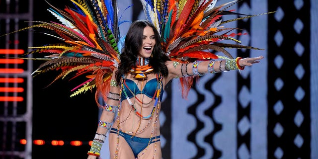 Adriana Lima has a new take on stripping down. Here the model walks the runway in Shanghai during the 2017 Victoria's Secret Fashion Show.