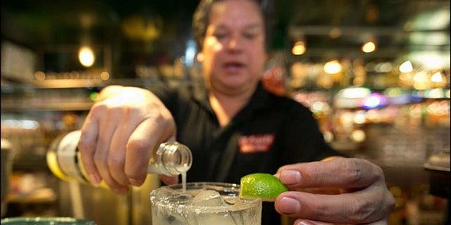 Bartender Mario Sanchez crafts a margarita cocktail at the bar of El Coyote, a Mexican restaurant in Los Angeles.