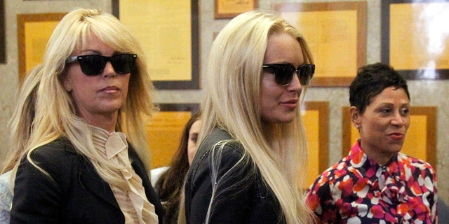 The Lohan family matriarch officially lost the house when she failed to show up to court to respond to JPMorgan Chase's lawsuit for foreclosure.