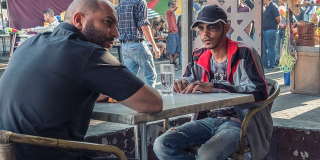 "Lior Raz (left) in a scene from the first episode of Season 2 of ""Fauda."""