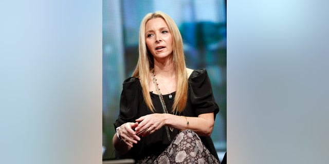 """August 4, 2011. Lisa Kudrow answers a question at the Showtime session for """"Web Therapy"""" during the 2011 Summer Television Critics Association Cable Press Tour in Beverly Hills, California."""