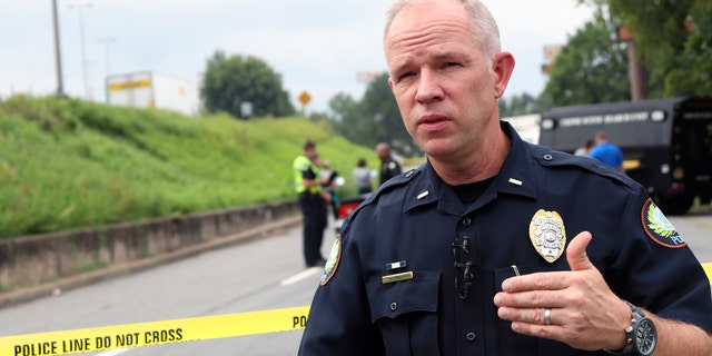 Little Rock Police Lt. Steve McClanahan speaks near an interstate in Little Rock.