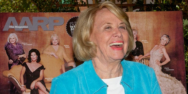 """Liz Smith, gossip columnist and author of the new book """"Dishing,"""" is all smiles during a Texas-style lunch celebrating AARP The Magazine's first Hollywood issue at the Bel-Air Hotel in Los Angeles, March 29, 2005. REUTERS/Jim Ruymen  JR - RP6DRMTHUPAA"""