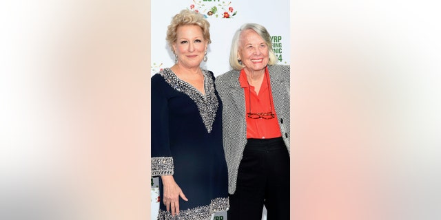 Gossip columnist Liz Smith (right) poses with actress Bette Midler (left).