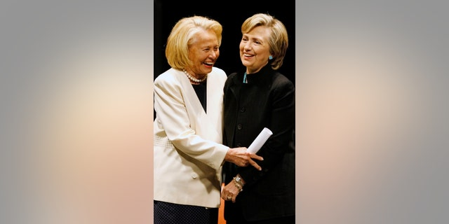 Gossip Columnist Liz Smith (left) poses with Hillary Clinton (right).