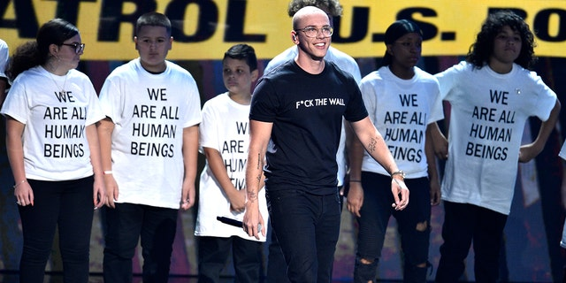 "Logic performs ""One Day"" onstage at the MTV Video Music Awards at Radio City Music Hall on Monday, Aug. 20, 2018, in New York."