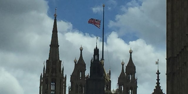 The British flag waves atop of a cathedral in London.