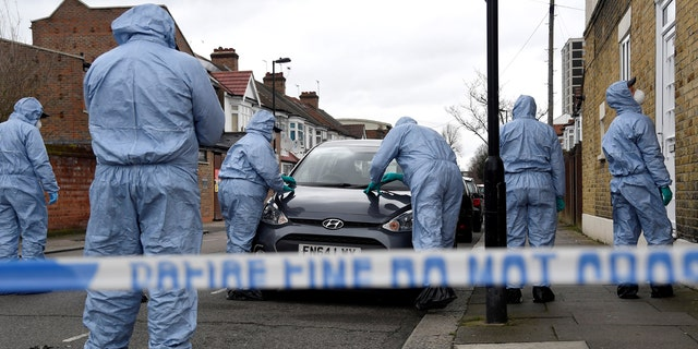 Forensic investigators examine the scene around Walthamstow Leisure Centre, where a teenage boy was shot, in London, Britain, April 3, 2018.