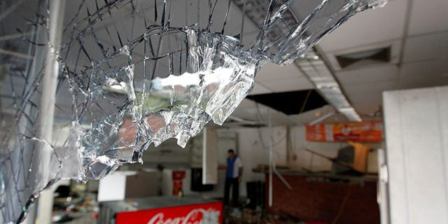 Broken glass is seen in a convenience store, after it was looted in Caracas, Venezuela April 21, 2017. REUTERS/Christian Veron - RTS13CRS