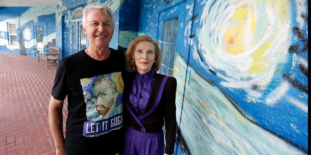 Lubomir Jastrzebski and Nancy Nemhauseer stand by a section of a mural at their home in Wednesday, July 18, 2018, in Mount Dora, Fla.