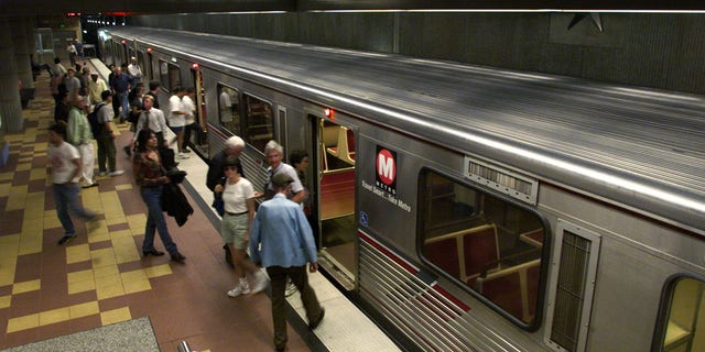 Passengers get off a Metro Red Line subway train at the Hollywood and Vine station in Hollywood. Metro may add portable showers at some stations across the system.
