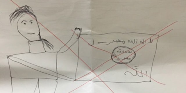 """Ahmed is faring better since being rescued from ISIS, and drew an """"X"""" through this picture."""