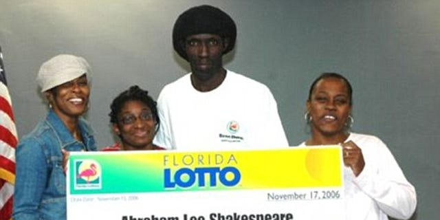 Abraham Shakespeare, center, pictured with family members after he won $30 million in the Florida State Lottery.