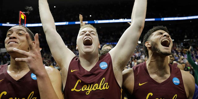 Loyola-Chicago players celebrate their Final Four berth after Saturday's win over Kansas State, in Atlanta, March 24, 2018.
