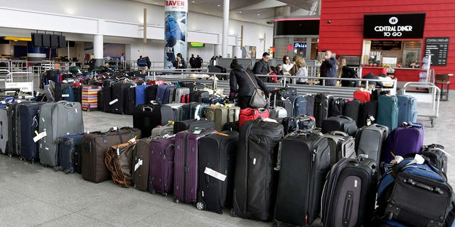 A water main break at JFK airport resulted in flooding, delayed flights, and power and heat outages. Some passengers were also forced to abandon their luggage.