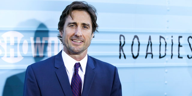 Luke Wilson helped pull a woman from a burning vehicle, a witness said.