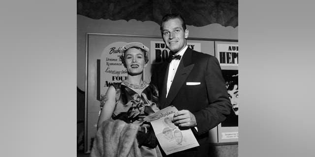 Lydia Clarke Heston, actress and wife of Charlton Heston, has died, Fox News can confirm. She was 95. The couple are pictured here in 1954.