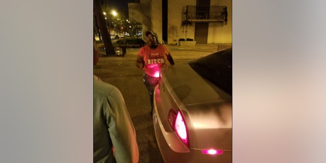 A Chicago Lyft driver allegedly points a gun at her passengers.