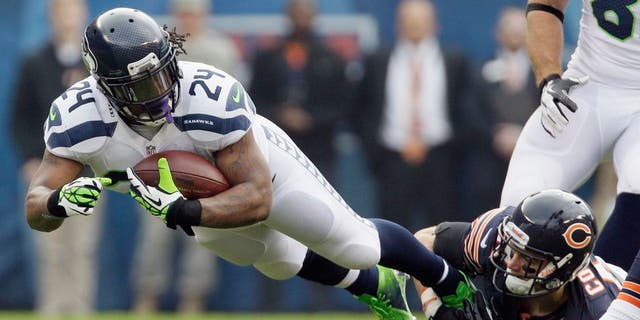 Seattle Seahawks running back Marshawn Lynch (24) is tackled by Chicago Bears free safety Chris Conte in the first half of an NFL football game in Chicago, Sunday, Dec. 2, 2012. (AP Photo/Nam Y. Huh)