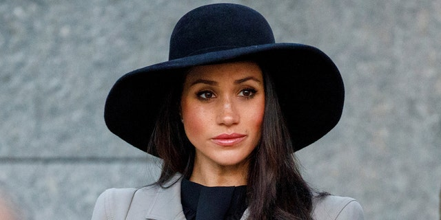 The bride-to-be wore a conservative ensemble for early morning Anzac Day services on April 25.