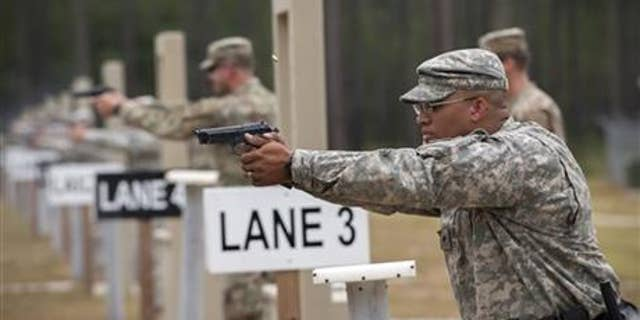 Members of the 139th Military Police Company train with their Beretta M9 at a range in Fort Stewart, Ga.