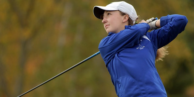 High school golfer Emily Nash tees off at the Central Mass. Division 3 Golf Tournament at Blissful Meadows.
