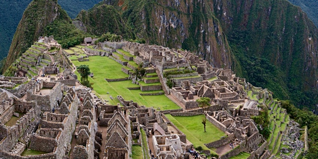 """Machu Picchu (Quechua: Machu Picchu) – """"Old Mountain"""", is a pre-Columbian Inca  site located 2,430 metres (7,970 ft) above sea level. It is situated on a mountain ridge above the Urubamba Valley in Peru, which is 80 kilometres (50 mi) northwest of Cuzco and through which the Urubamba River flows. Most archaeologists believe that Machu Picchu was built as an estate for the Inca emperor Pachacuti  (1438–1472). Often referred to as """"The Lost City of the Incas"""", it is perhaps the most familiar icon of the Inca World. Machu Picchu was declared a Peruvian Historical Sanctuary in 1981 and a UNESCO World Heritage Site in 1983. Since it was not plundered by the Spanish when they conquered the Incas, it is especially important as a cultural site and is considered a sacred place."""