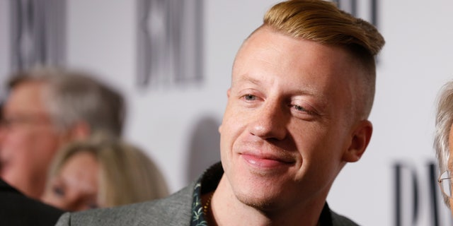 Musician Macklemore poses at the 62nd Annual BMI Pop Awards in Beverly Hills, California, May 13, 2014.