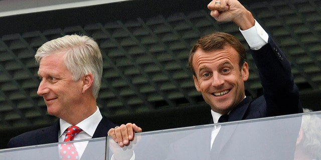 French President Emmanuel Macron and Belgian King Philippe watch the pre-match festivities in Saint Petersburg.