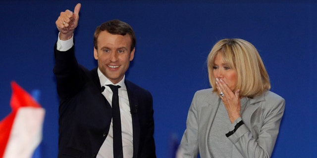 Emmanuel Macron with his wife, Brigitte Trogneux, on Sunday.