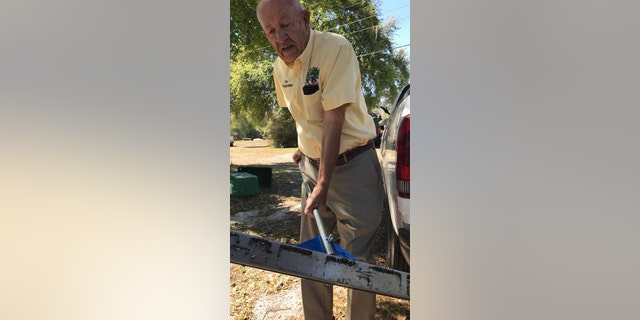Oak Hill Mayor Doug Gibson collects nails using a magnetic roller the city just purchased to deal with the problem.