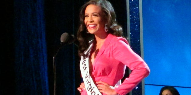 Miss West Virginia Madeline Collins introduces herself during the third and final night of preliminary competition in the Miss America pageant in Atlantic City N.J., Sept. 7, 2018.