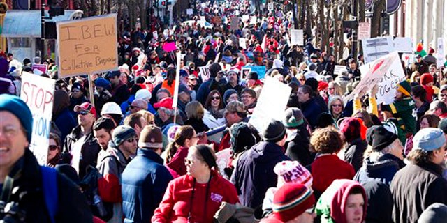 Protesters gather in Madison, Wis., after a rally outside the Wisconsin State Capitol on Feb. 19.