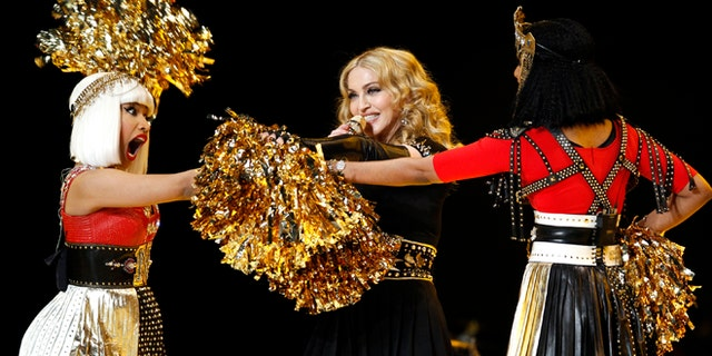Madonna performs during the halftime show with Nicki Minaj (L) and M.I.A. in the NFL Super Bowl XLVI football game in Indianapolis, Indiana, February 5, 2012. REUTERS/Mike Segar (UNITED STATES  - Tags: SPORT FOOTBALL) - RTR2XDU8