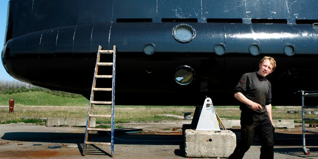 This April 30, 2008 file photo shows a submarine and its owner, Peter Madsen