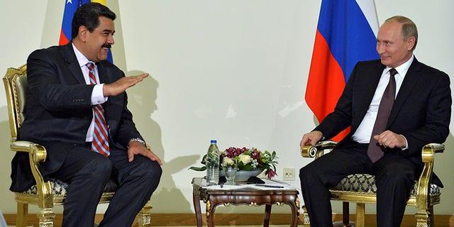 Russian President Vladimir Putin and Venezuelan President Nicolas Maduro in Istanbul, Turkey, Oct. 10, 2016.