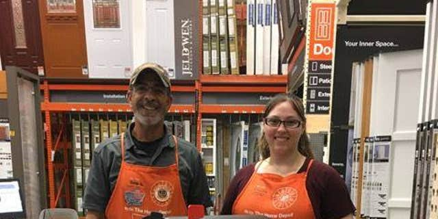 Two Home Depot employees show off Cameron's mailbox.