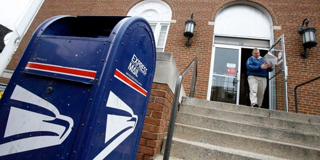 A man leaves the U.S. post office in Blacksburg, Virginia April 19, 2007.