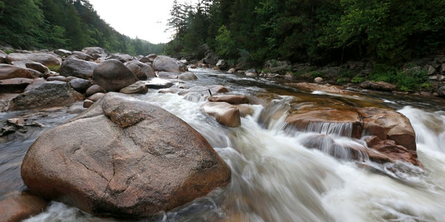 In this Aug. 4, 2015, file photo, the Wassataquoik Stream flows through Township 3, Range 8, Maine, on land owned by environmentalist Roxanne Quimby, the founder of Burts Bees.