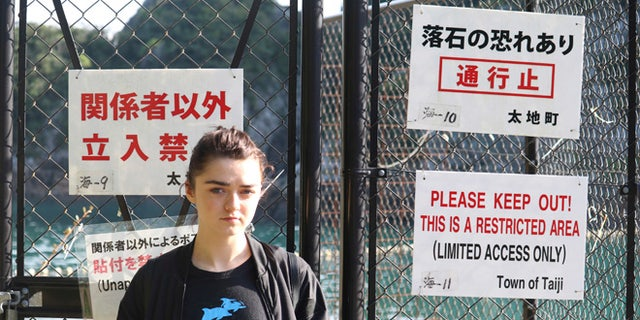 Maisie Williams at a beach known for dolphin hunting in Taiji, Japan.