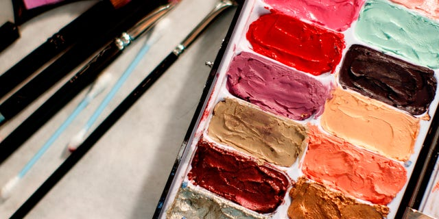 A makeup palette is seen on a table backstage before the Emerson Fall/Winter 2012 collection show during New York Fashion Week February 14, 2012. REUTERS/Carlo Allegri