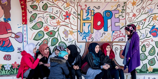 Girls outside a refugee school in Lebanon, built by Malala Fund.