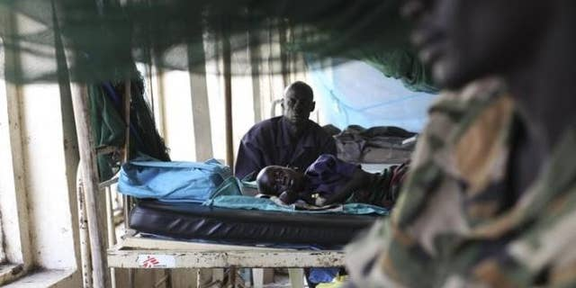 March 15, 2014: A child sick with malaria and from malnutrition lies on a bed in a hospital in Bor.