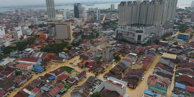 An aerial view shows a flooded George Town city in Penang, Malaysia, Sunday, Nov. 5, 2017. A northern Malaysian state has been paralyzed by a severe storm that led to two deaths and some 2,000 people evacuated in the worst flooding in years, officials say. (AP Photo)