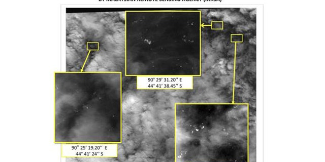 A satellite photo, showing the locations and coordinates of unknown objects reported by the Malaysian Remote Sensing Agency (MRSA) in the Indian Ocean, is seen in this handout photo taken by the MRSA on March 23, 2014 and released to Reuters on March 26, 2014.